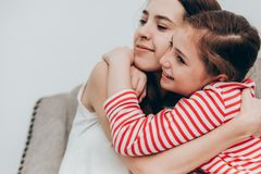 Beautiful mother and daughter hugging together at home,Family co. Ncept Stock Images