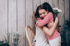 Beautiful mother and daughter hugging Stock Photography