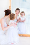 Beautiful mother and daughter at a mirror Royalty Free Stock Images