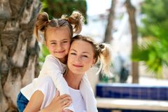 Beautiful mother and daughter outdoors Royalty Free Stock Photos