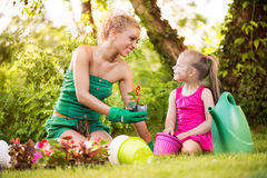 Beautiful mother and daughter planting flowers Royalty Free Stock Image
