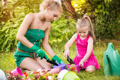 Beautiful mother and daughter planting flowers Royalty Free Stock Images