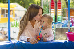 Beautiful mother and daughter playing in fishing Stock Photo