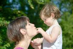 A beautiful mother and daughter playing stock images