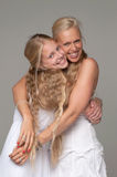 Beautiful mother and daughter posing in white dresses Royalty Free Stock Image
