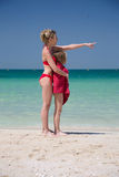 Beautiful mother and daughter in red swimsuit at beach Royalty Free Stock Photography