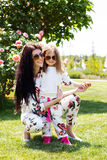 Beautiful mother and daughter relaxing on grass Royalty Free Stock Photos