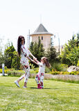 Beautiful mother and daughter relaxing on grass Royalty Free Stock Images
