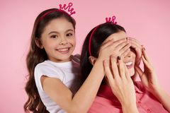 Beautiful mother and daughter in sham crowns stock photo