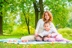 Beautiful mother and daughter spend a weekend at a picnic Royalty Free Stock Photos