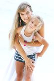 Beautiful mother and daughter in summer clothes Royalty Free Stock Photos