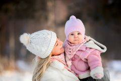Beautiful Mother and daughter winter portrait royalty free stock image