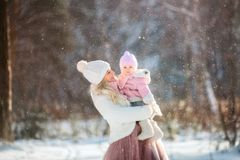 Beautiful Mother and daughter winter portrait stock images