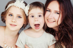 Beautiful Mother and Daughters. Cute Girls Royalty Free Stock Images