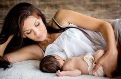 Beautiful mother feeding her newborn Royalty Free Stock Photo