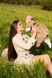 Beautiful mother having fun with her little cute baby in summer garden Stock Image