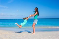 Beautiful mother and her adorable little daughter enjoy summer vacation Royalty Free Stock Image