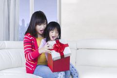 Beautiful mother and her child feel surprised Stock Photo