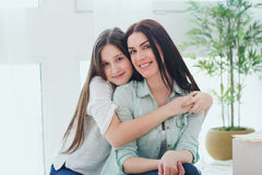 Beautiful mother and her cute daughter smiling and posing at home. stock photos