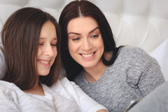 Beautiful mother and her cute daughter talking each other stock photography