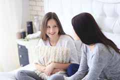 Beautiful mother and her cute daughter talking each other royalty free stock photography