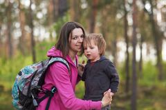 Beautiful mother and her cute son walking in the park. At sunny day Royalty Free Stock Photography