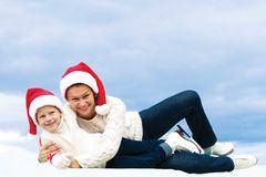 Beautiful mother and her daughter hugging at Christmas Royalty Free Stock Photos