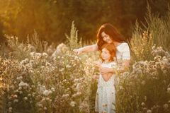 Beautiful Mother And her daughter outdoors. Nature. Outdoor Portrait of happy family royalty free stock photos