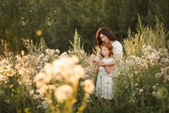 Beautiful Mother And her daughter outdoors. Nature. Outdoor Portrait of happy family stock photo
