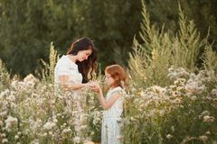 Beautiful Mother And her daughter outdoors. Nature. Outdoor Portrait of happy family stock photography