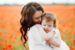 Mother and daughter playing in flower field Royalty Free Stock Image