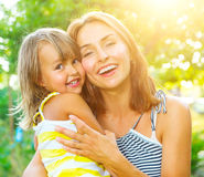 Beautiful mother and her little daughter Royalty Free Stock Photos