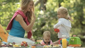 Beautiful mother with her little daughters on the stock footage