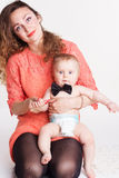 Beautiful mother holding baby boy Royalty Free Stock Image