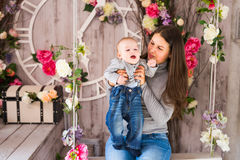Beautiful mother holding baby boy, mom carry cute child adorable small son, happy family picture, happiness concept Royalty Free Stock Photos