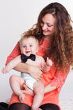 Beautiful mother holding baby boy in studio Royalty Free Stock Photo