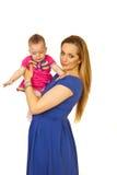 Beautiful mother holding baby girl Stock Photos