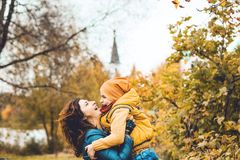 Beautiful mother holding her disabled son. At park royalty free stock photo