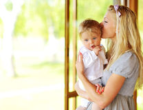 Beautiful mother kissing her adorable little son outdoors Royalty Free Stock Photography