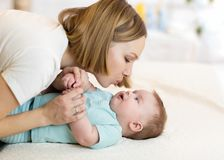 Beautiful mother kissing her baby Royalty Free Stock Photography