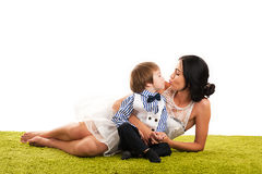Beautiful mother kissing son. Isolated on white background Stock Photos