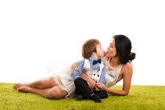 Beautiful mother kissing son Stock Photos