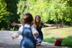 Beautiful mother and little daughter walking in summer park Stock Image