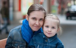 Beautiful mother and little daughter Stock Photo
