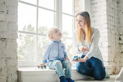 Beautiful Mother and Little Son Playing with Toys. At Home Royalty Free Stock Image