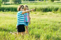 Beautiful mother outdoors with happy daughter child. Royalty Free Stock Photo