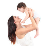Beautiful mother raising her daughter looking with tenderness Royalty Free Stock Photography