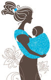 Beautiful mother silhouette. With baby in a sling Stock Photography