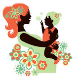 Beautiful mother silhouette with baby. In flowers Stock Photography