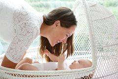 Beautiful mother smiling with cute baby Stock Image